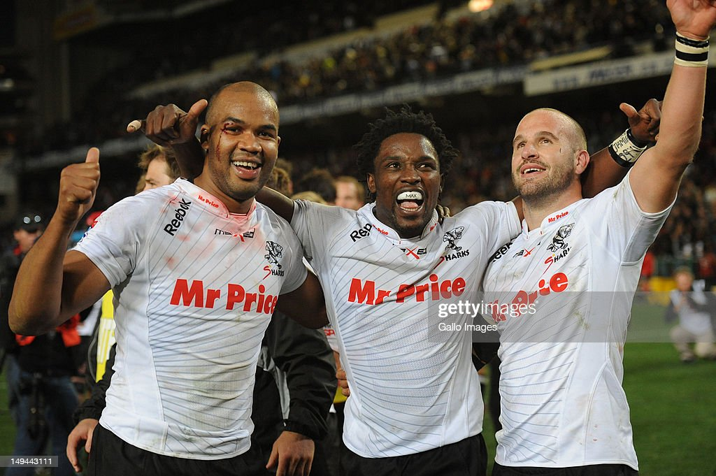 JP Pietersen, Lwazi Mvovo and Frederic Michalak of the Sharks celebrate victory in the Super Rugby semi final match between DHL Stormers and The Sharks from DHL Newlands Stadium on July 28, 2012 in Cape Town, South Africa.