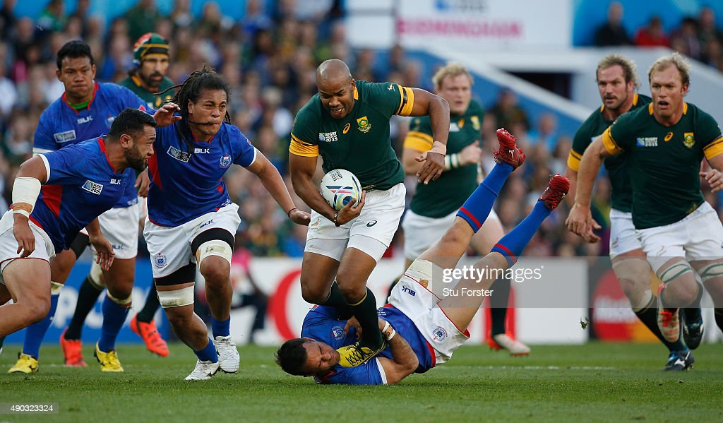 JP Pietersen of South Africa breaks past Mike Stanley of Samoa during the 2015 Rugby World Cup Pool B match between South Africa and Samoa at Villa Park on September 26, 2015 in Birmingham, United Kingdom.