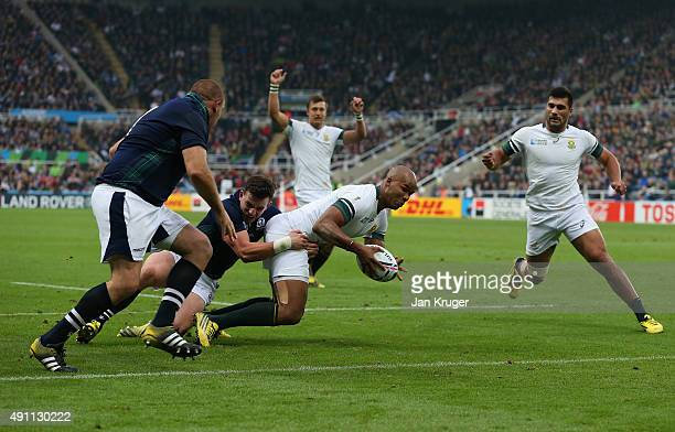 Pietersen of South Africa goes over to score their second try during the 2015 Rugby World Cup Pool B match between South Africa and Scotland at St...