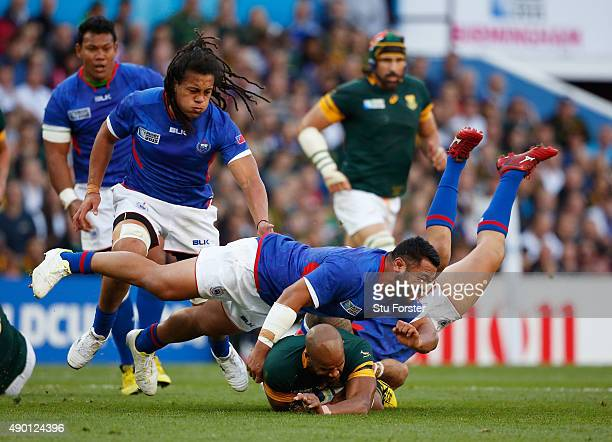 Pietersen of South Africa is tackled by Motu Matu'u of Samoa during the 2015 Rugby World Cup Pool B match between South Africa and Samoa at Villa...