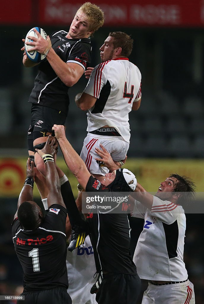 Pieter-Steph du Toit of Sharks takes the line out ball from Luke Romano of Crusaders during the Super Rugby round eight match between The Sharks and Crusaders from Kings Park on April 05, 2013 in Durban, South Africa.