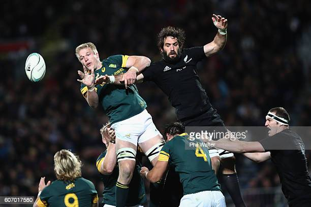 PieterSteph Du Toit of South Africa clears the ball from the lineout under pressure from Sam Whitelock of the All Blacks during the Rugby...