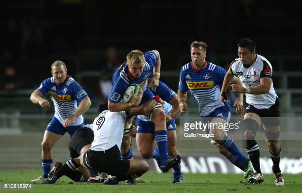 PieterSteph du Toit of the Stormers attempts to break Keisuke Uchida of Sunwolves tackle during the Super Rugby match between DHL Stormers and...