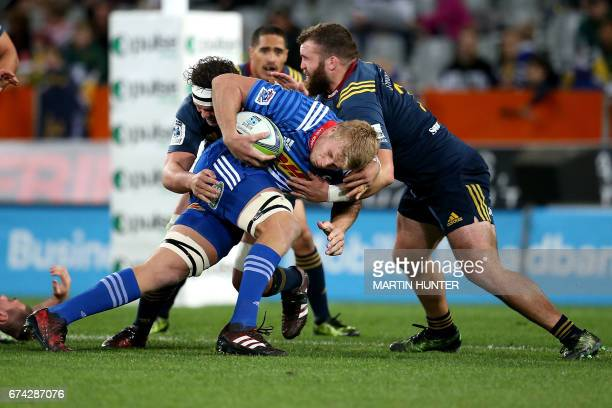 PieterSteph du Toit of the Western Stormers is held in a tackle by Liam Coltman of the Otago Highlanders during the Super Rugby match between the...