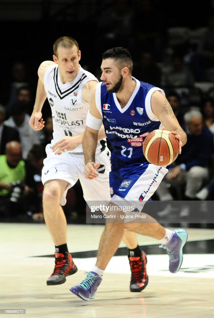 Pietro Aradori of Lenovo competes with Mason Rocca of Oknoplast during the LegaBasket A1 basketball match between Oknoplast Bologna and Lenovo Cantu at Unipol Arena on May 5, 2013 in Bologna, Italy.