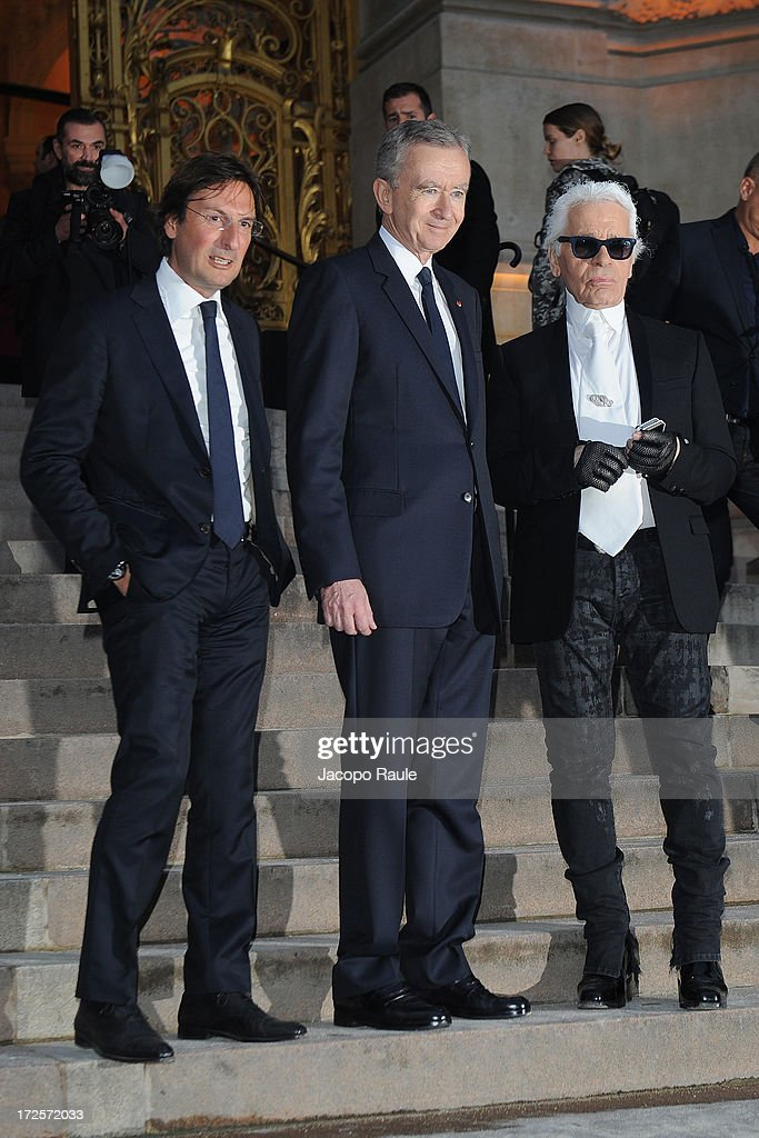 Pietro Beccari, Bernard Arnault and Karl Lagerfeld arrive at 'The Glory Of Water' : Karl Lagerfeld's Exhibition Dinner at Fendi on July 3, 2013 in Paris, France.