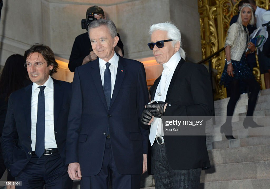 Pietro Beccari, <a gi-track='captionPersonalityLinkClicked' href=/galleries/search?phrase=Bernard+Arnault&family=editorial&specificpeople=214118 ng-click='$event.stopPropagation()'>Bernard Arnault</a> and <a gi-track='captionPersonalityLinkClicked' href=/galleries/search?phrase=Karl+Lagerfeld+-+Fashion+Designer&family=editorial&specificpeople=4330565 ng-click='$event.stopPropagation()'>Karl Lagerfeld</a> arrive at the The Glory of Water' <a gi-track='captionPersonalityLinkClicked' href=/galleries/search?phrase=Karl+Lagerfeld+-+Fashion+Designer&family=editorial&specificpeople=4330565 ng-click='$event.stopPropagation()'>Karl Lagerfeld</a>'s exhibition at Fendi Store After Party : Outside Arrivals At the Petit Palais on July 3 on July 3, 2013 in Paris, France.