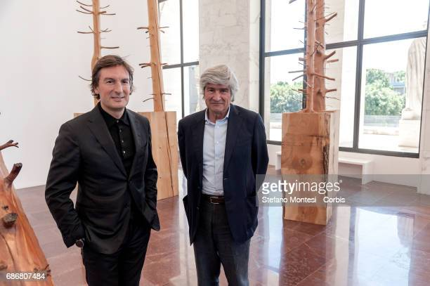 Pietro Beccari Chairman and Ceo of Fendi and Giuseppe Penone during a press preview for an art installation entitled 'Foglie di Pietra' by Giuseppe...