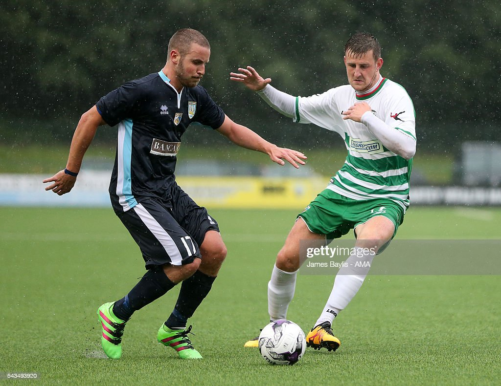 Pietro Calzolari of SP Tre Penne and Scott Quigley of The New Saints during the UEFA Champions League First Round Qualifier match between The New Saints and SP Tre Penne at Park Hall on June 28, 2016 in Oswestry, England.