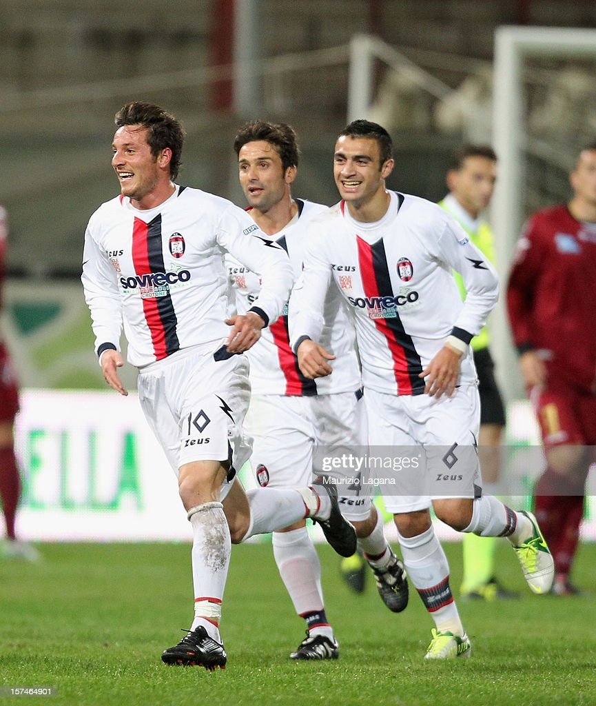Pietro De Giorgio (L) of Crotone celebrates after scoring his team's opening goal during the Serie B match between Reggina Calcio and FC Crotone at Stadio Oreste Granillo on December 3, 2012 in Reggio Calabria, Italy.