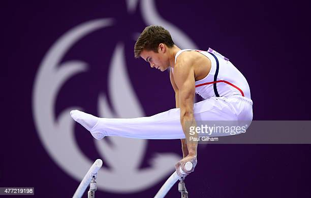 Pietro Giachino of Norway competes on the parallel bars during the Men's Artistic Gymnastics Team and All Around qualification on day three of the...
