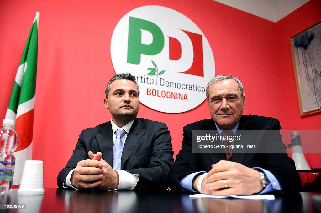 Pietro Grasso (R), candidate with PD (Democratic Party) for the next political elections, attends a meeting with PD supporters, at Circolo PD 'Bolognina' on February 2, 2013 in Bologna, Italy. The elections are being held on February 24/25.