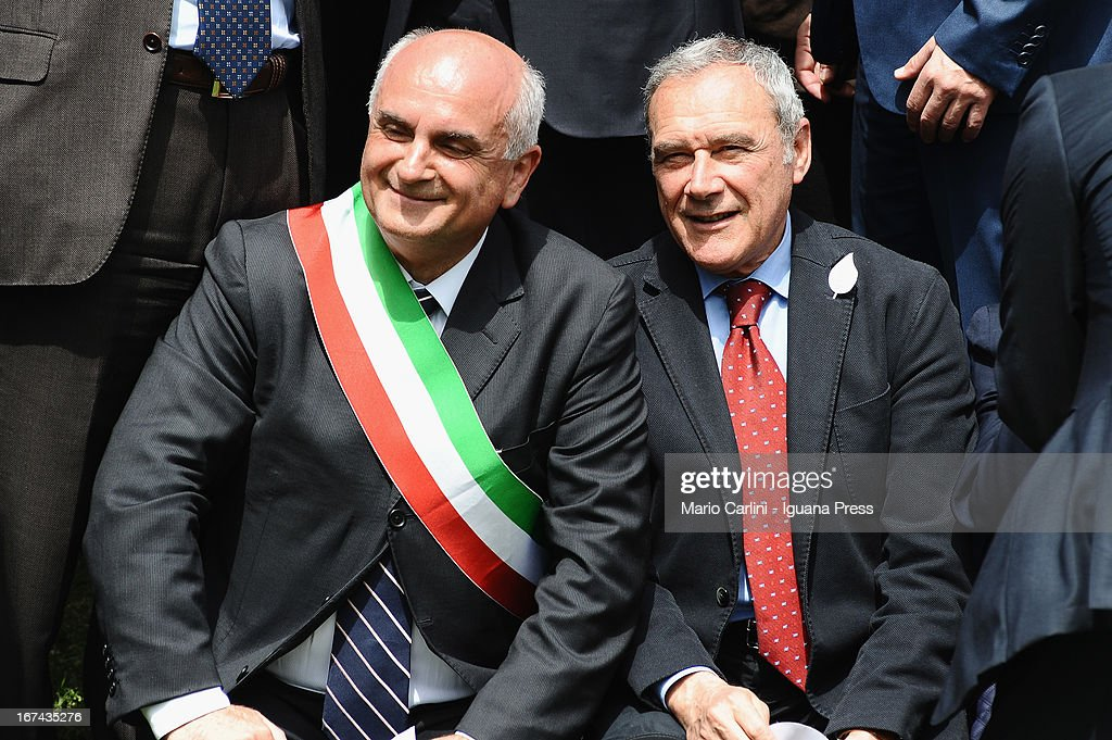 Pietro Grasso, President of the Senate of Italian Republic (R) and Romano Franchi, Mayor of Marzabotto attend a celebration of the 68th anniversary of liberation and end of WWII at san Martino di Caparara on April 25, 2013 in Marzabotto, Italy.