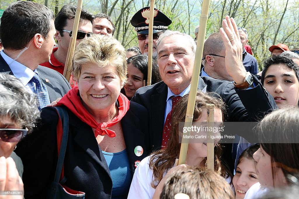 Pietro Grasso, President of the Senate of Italian Republic ( C-R) and Susanna Camusso, General Secretary of CGIL (L) attend a celebration of the 68th anniversary of liberation and end of WWII at san Martino di Caparara on April 25, 2013 in Marzabotto, Italy.