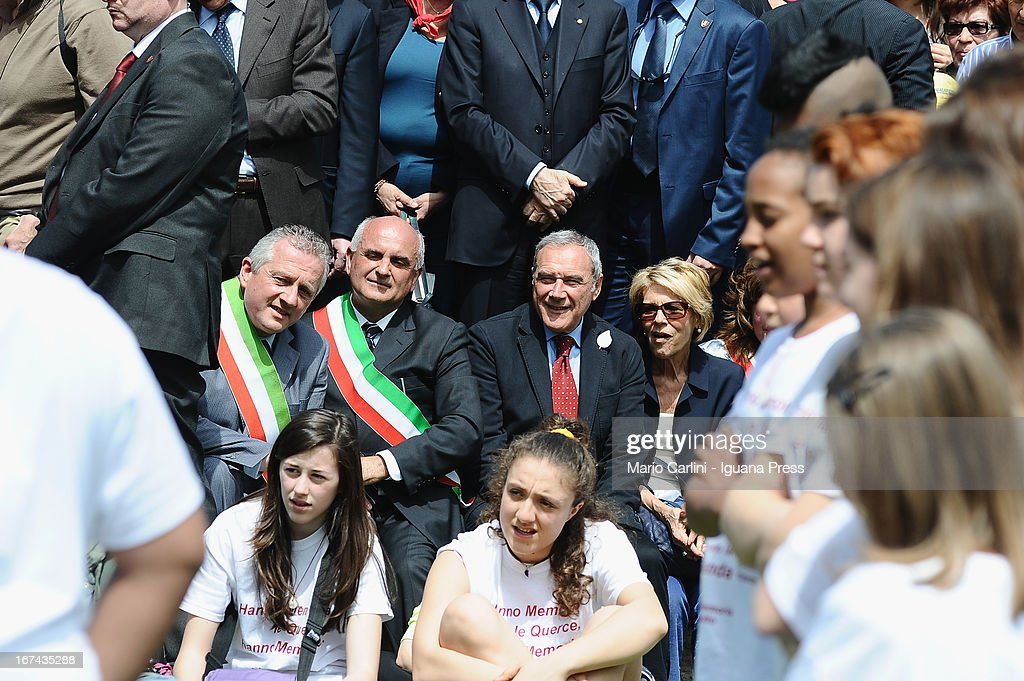 Pietro Grasso, President of the Senate of Italian Republic (C) and wife Maria with Romano Franchi, Mayor of Marzabotto, as they attend a celebration of the 68th anniversary of liberation and end of WWII at san Martino di Caparara on April 25, 2013 in Marzabotto, Italy.
