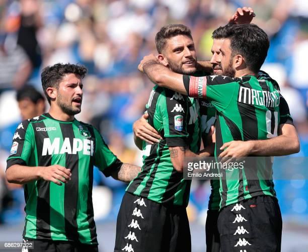 Pietro Iemmello of US Sassuolo Calcio celebrates his goal with his teammates Francesco Magnanelli Domenico Berardi and Stefano Sensi during the Serie...
