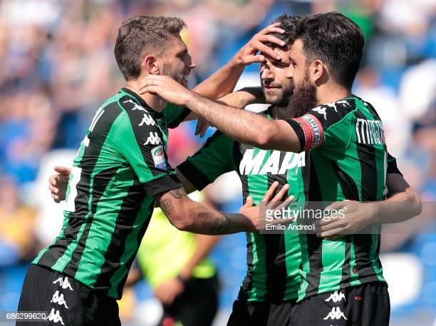Pietro Iemmello of US Sassuolo Calcio celebrates his goal with his teammates Francesco Magnanelli and Domenico Berardi during the Serie A match...