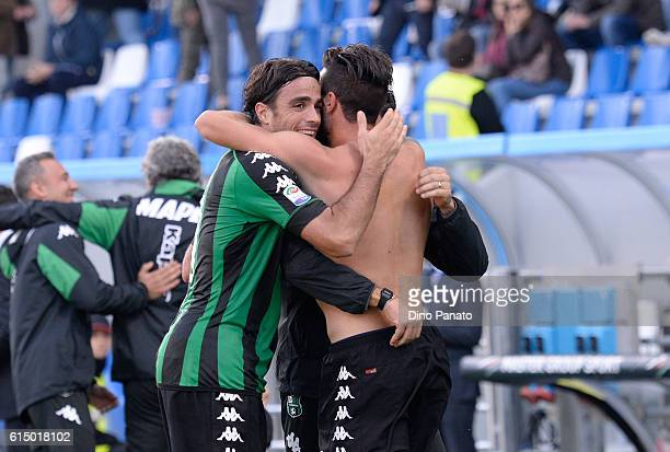 Pietro Iemmello of US Sassuolo celebrates with his team' mate Alessandro Matri after scoring his team's second goal during the Serie A match between...