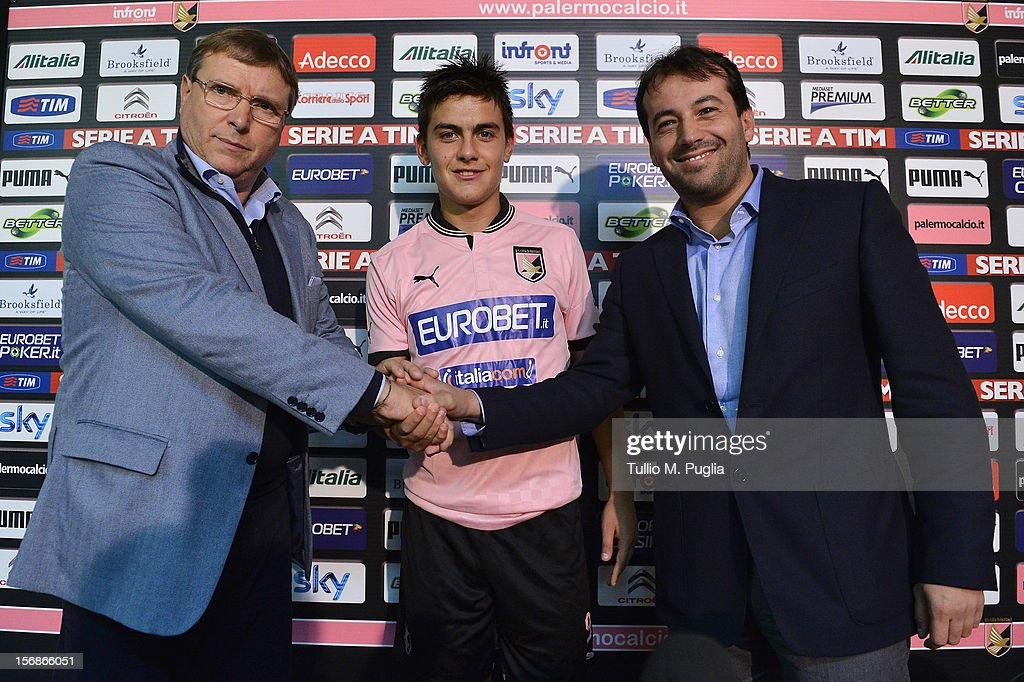 Pietro Lo Monaco CEO of Palermo Paulo Dybala and Salvatore Castagna CEO of Italiacom pose during new sponsorship unveiling at Tenente Carmelo Onorato...