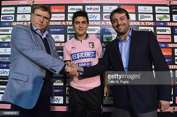Pietro Lo Monaco CEO of Palermo Paulo Dybala and Salvatore Castagna CEO of Italiacom pose during new sponsorship unveiling at Tenente Carmelo Onorato...