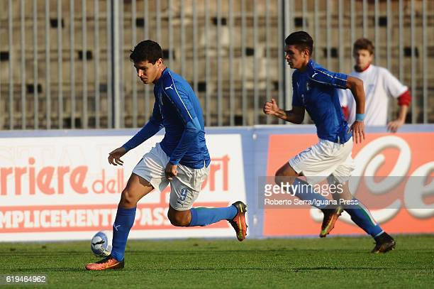 Pietro Pellegri and Raoul Bellanova of Italy handles the ball during the UEFA European Under17 Championship Qualifier between Italy and Serbia at...