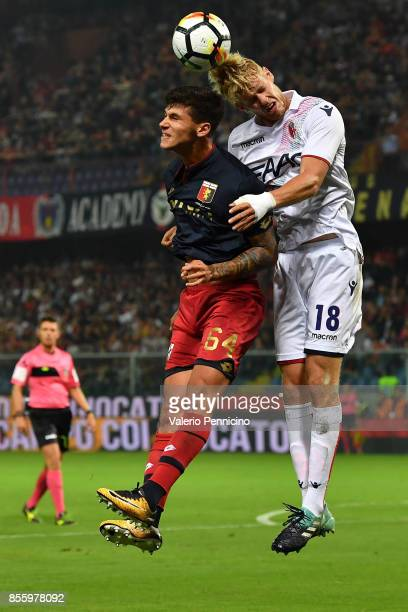 Pietro Pellegri of Genoa CFC clashes with Filip Helander of Bologna FC during the Serie A match between Genoa CFC and Bologna FC at Stadio Luigi...