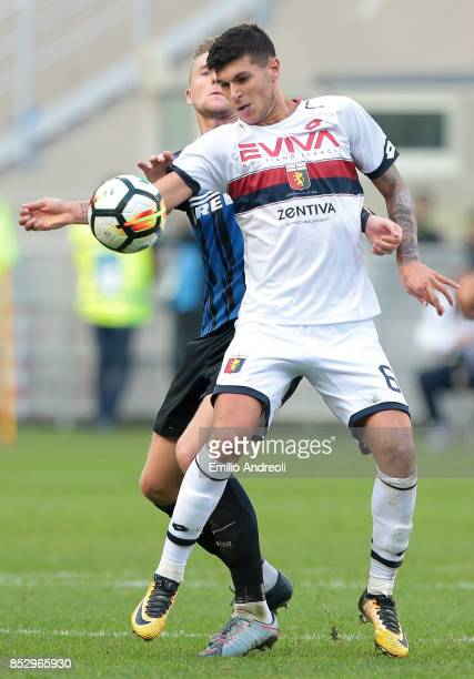 Pietro Pellegri of Genoa CFC is challenged by Milan Skriniar of FC Internazionale Milano during the Serie A match between FC Internazionale and Genoa...