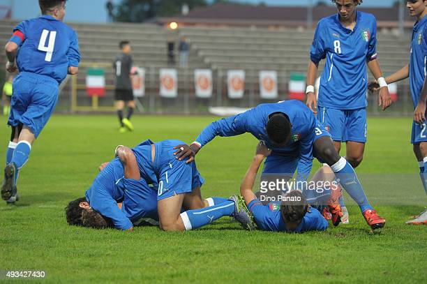 Pietro Pellegri of Italy U16 is mobbed by team mates after scoring his opening goal during the international friendly match between Italy U16 and...