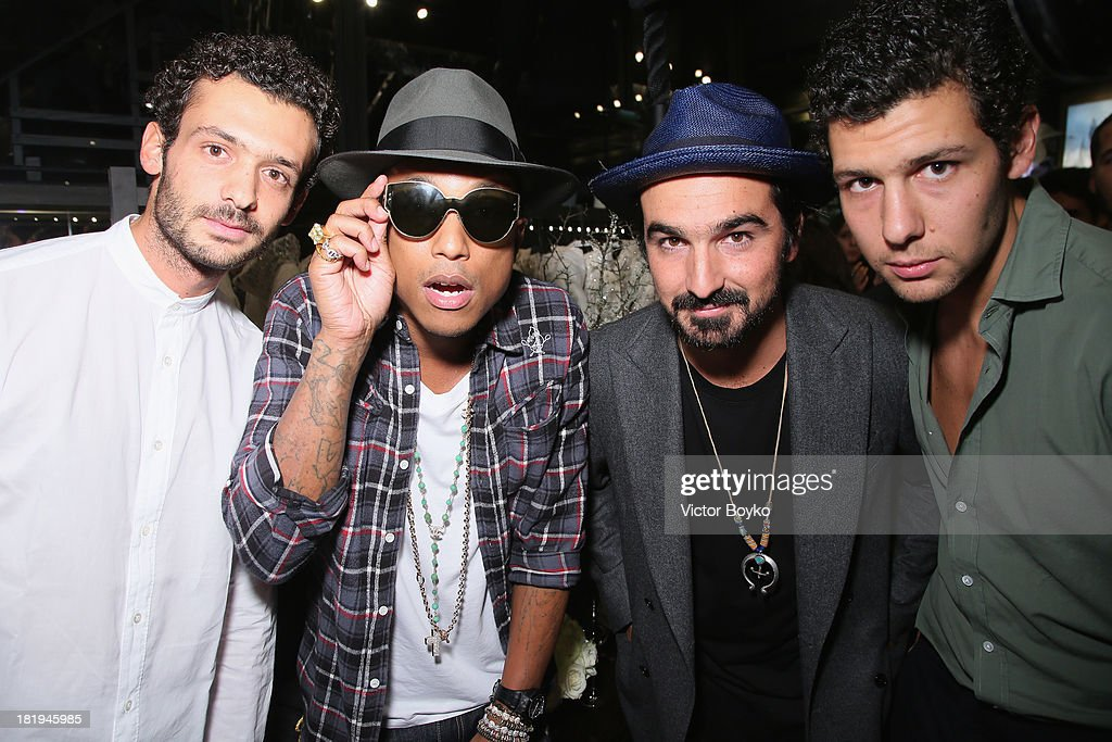 Pietro Ruffini, singer/producer Pharrell Williams, guest and Romeo Ruffini attend the cocktail for the Moncler New Flagship Opening in Paris at Rue Du Faubourg Saint-Honore on September 26, 2013 in Paris, France.