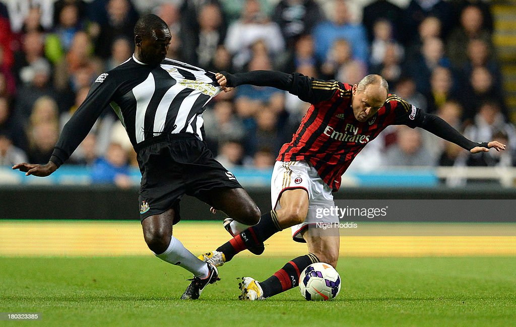 Pietro Vierchowod (R) of AC Milan Glorie vies for the ball with Andy Cole (L) of Newcastle United during Steve Harper's testimonial match between Newcastle United and AC Milan Glorie at St James' Park on September 11, 2013 in Newcastle upon Tyne, England.