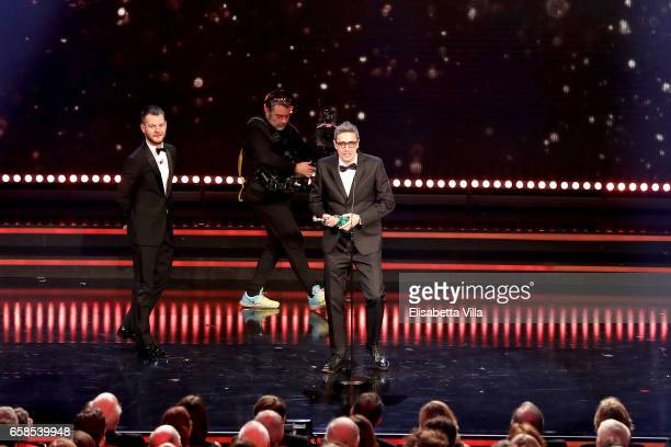 Pif receives the 'David Giovani' Award from Alessandro Cattelan during the 61 David Di Donatello ceremony on March 27 2017 in Rome Italy