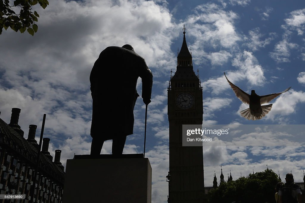 A pigeon flies past a statue of Winston Churchill and the Houses of Parliament the day after the majority of the British public voted to leave the European Union on June 25, 2016 in London, England. The ramifications of the historic referendum yesterday that saw the United Kingdom vote to Leave the European Union are still being fully understood. The Labour leader, Jeremy Corbyn, who is under pressure from within his party to resign has blamed the 'Brexit' vote on 'powerlessness', 'austerity' and peoples fears over the issue of immigration.