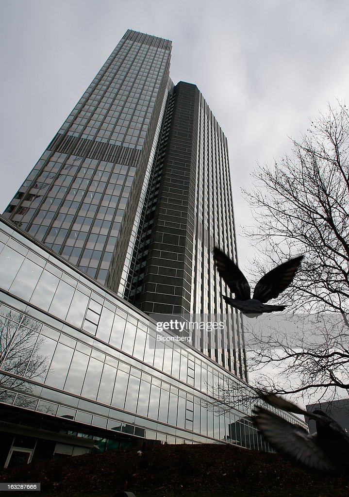 A pigeon flies towards the headquarters of the European Central Bank (ECB) in Frankfurt, Germany, on Thursday, Mar. 7, 2012. The European Central Bank left interest rates on hold as it gauges how big a threat Italy poses to the economic recovery. Photographer: Ralph Orlowski/Bloomberg via Getty Images