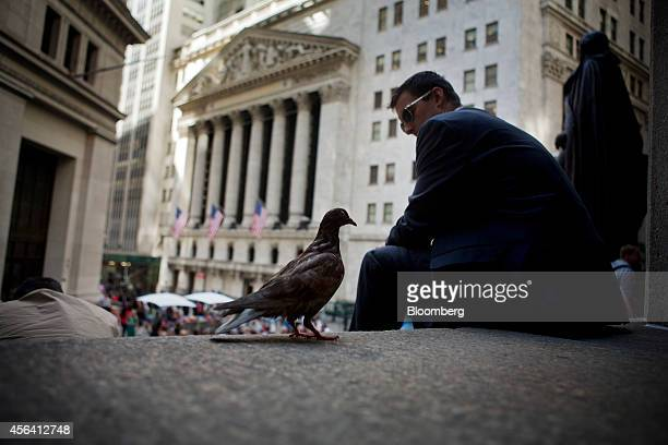 A pigeon stands on the steps of Federal Hall across from the New York Stock Exchange in New York US on Friday Sept 26 2014 The SP 500 finished the...