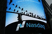Pigeons are seen in front the Nasdaq MarketSite in New York's Times Square in New York City on June 16 2015 US stocks snapped a twoday losing streak...
