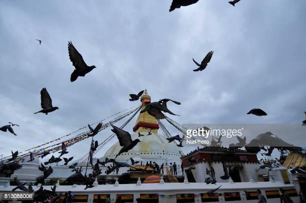 Pigeons flies over at Boudhanath Stupa Kathmandu Nepal on Tuesday July 11 2017 Boudhanath Stupa is listed as a UNESCO heritage site in Kathmandu Nepal