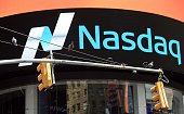 Pigeons on a light pole in Times Square near the Nasdaq Stock Market August 24 2015 in New York US stocks opened down more than five percent Monday...