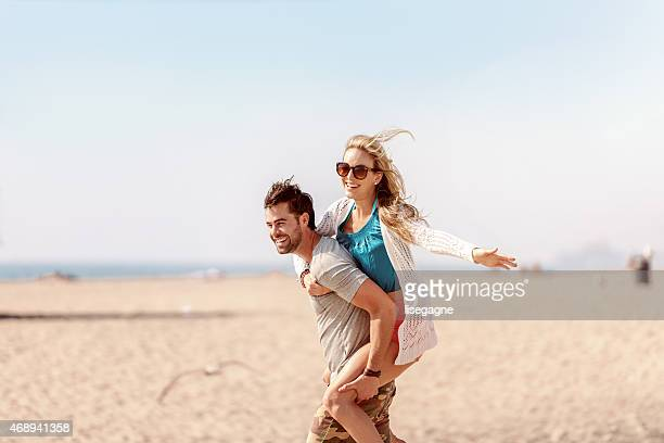 Piggy back at the beach