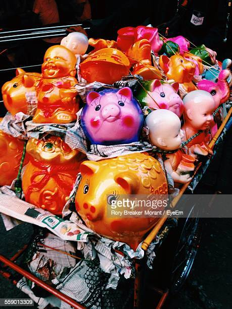 Piggy Bank And Buddha Figurines In Shopping Cart