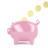 Filling piggy bank with golden coins