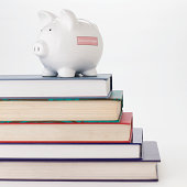 Piggy bank and stack of books