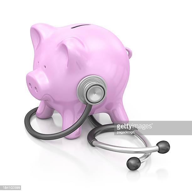 Tirelire en forme de cochon et stéthoscope