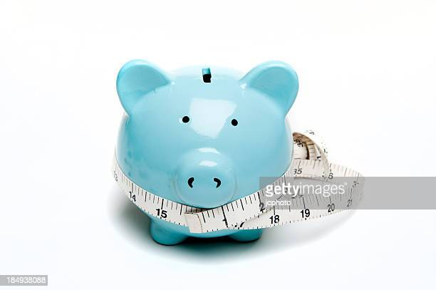 Piggy bank and tape measure