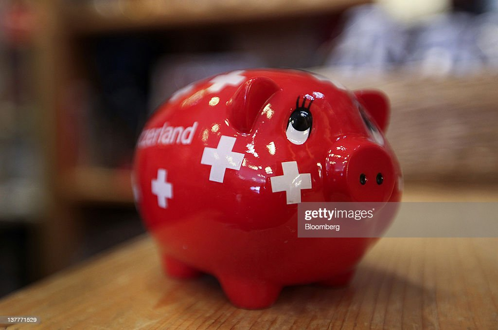 A piggy bank are displayed for sale in a souvenir shop during day two of the World Economic Forum (WEF) in Davos, Switzerland, on Thursday, Jan. 26, 2012. The 42nd annual meeting of the World Economic Forum will be attended by about 2,600 political, business and financial leaders at the five-day conference. Photographer: Chris Ratcliffe/Bloomberg via Getty Images
