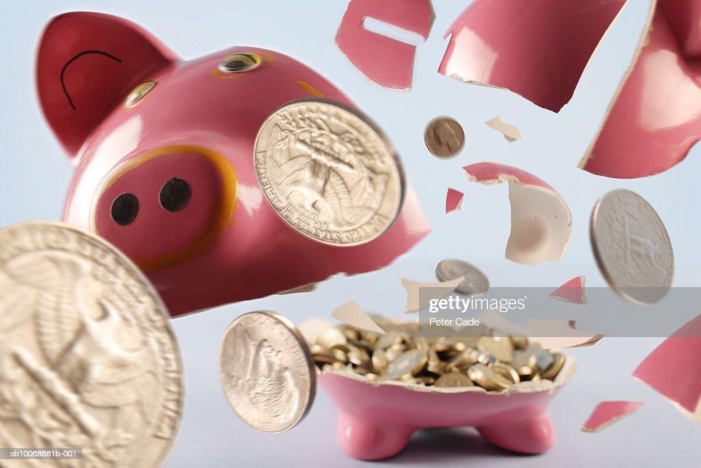 Piggy bank exploding : Stock Photo
