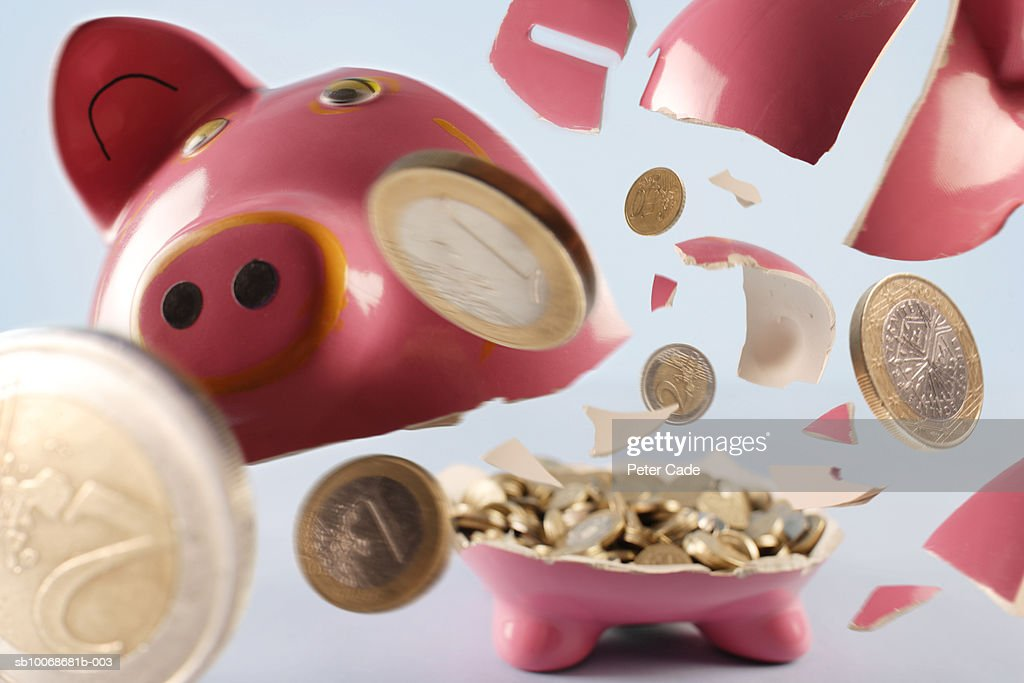 Piggy bank exploding : Stock Photo