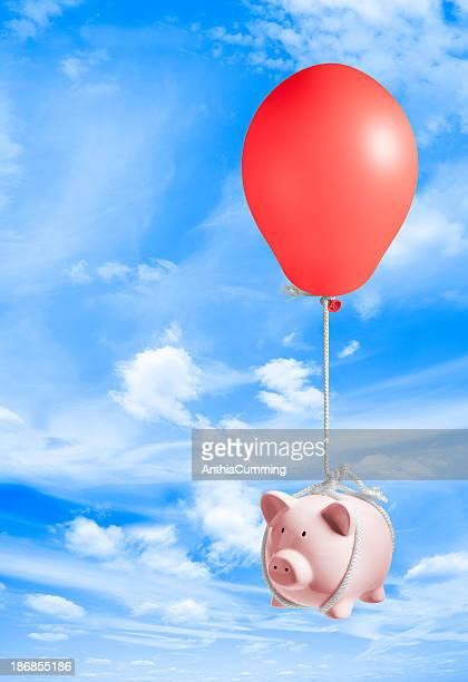 Tirelire en forme de cochon coudes en ciel par pression de