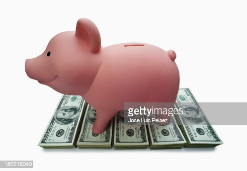 Piggy Bank on top of hundred dollar bills : Foto stock
