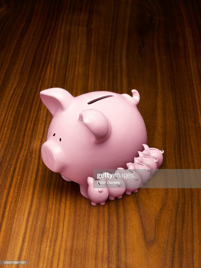 Piggy bank with baby piggy banks suckling (digital composite) : Stock Photo