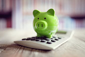 Piggy bank on calculator concept for saving, accounting, banking and business account